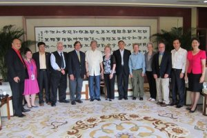 Mr. Xu in the white shirt in the center, with the leader of the U.S. trade delegation firmly planted between me and Mr. Xu