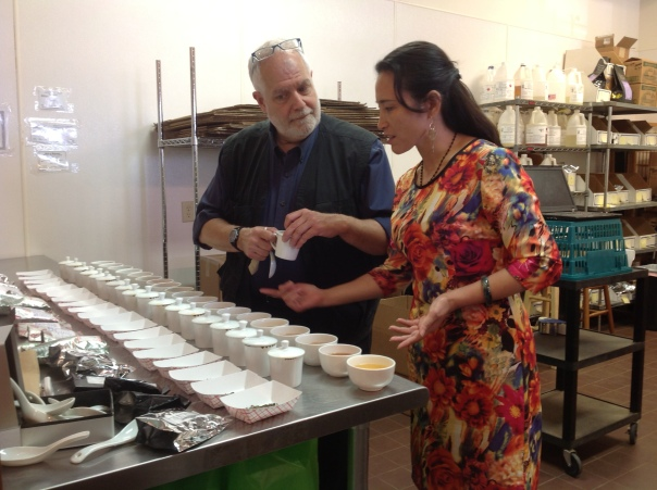 Ms Z and I getting ready to cup and evaluate around 30 very fresh Indian teas.  She really makes me think I have to re-evalutate  the TeaSource dress code.