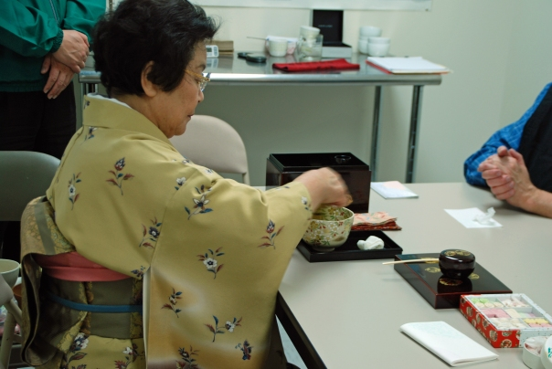 A demonstration of grace and focus, whisking the tea.